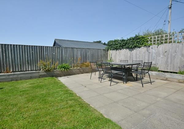 Garden with patio table and chairs