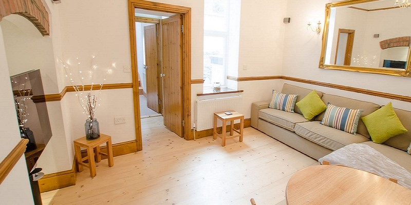 Lounge and dining area at Holiday home in croyde