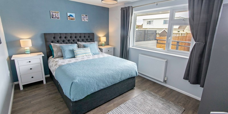 Master bedroom with space for a cot