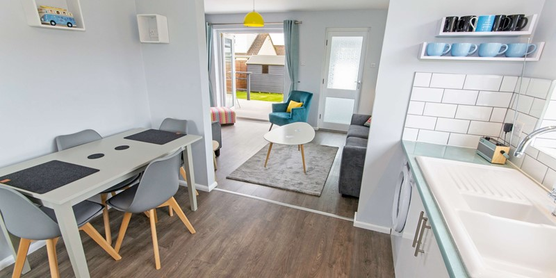 Open plan living with patio doors to the terrace