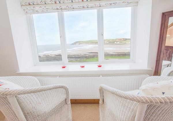 Master bedroom couple seating with the view of Croyde bay North Devon