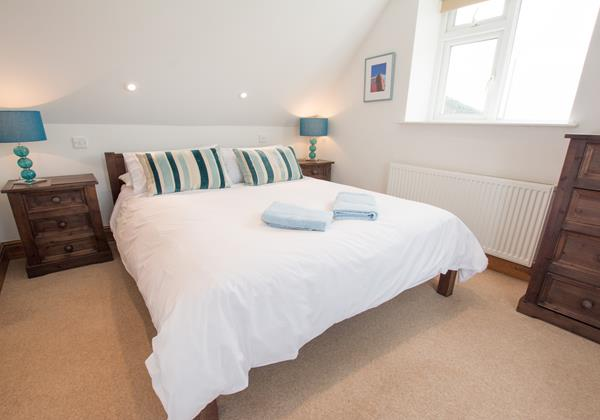 Kingsize bed with views out to Hartland and Croyde Bay North Devon