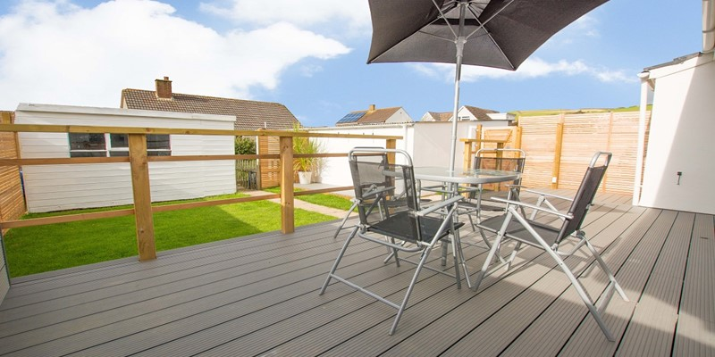 Beach style decking BBQ seating area