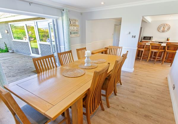 Large dining table open plan kitchen