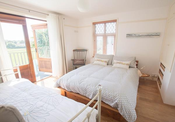 Step out balcony from this bedroom