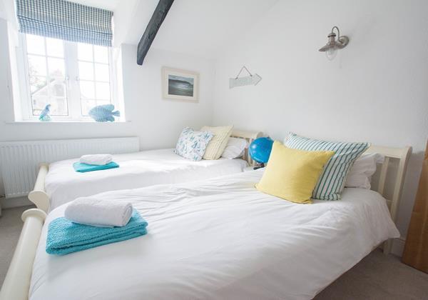 White crisp twin bedded room