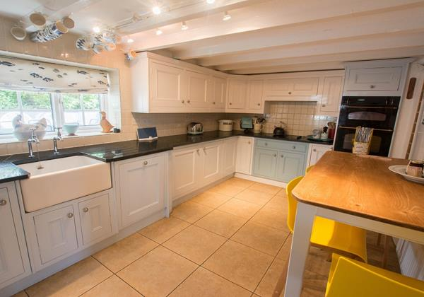 Galley kitchen with breakfast seating