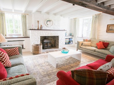Cottage lounge with beamed ceiling