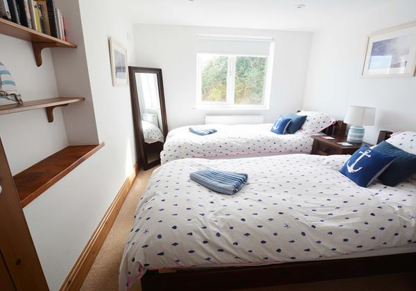 Twin beds with shower room next door located downstairs