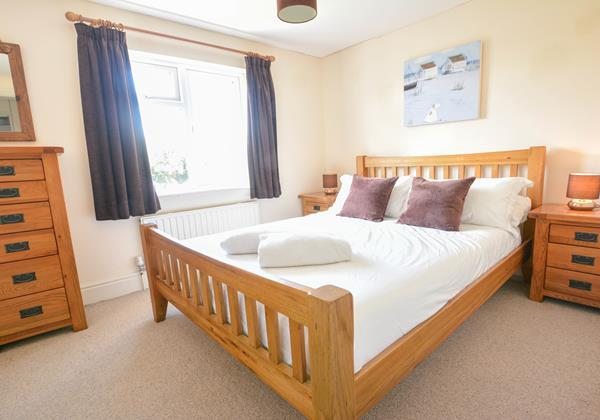 Double bedroom with grand oak furniture