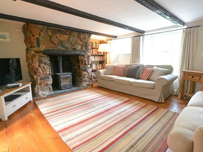 Cozy lounge with beamed cottage charm