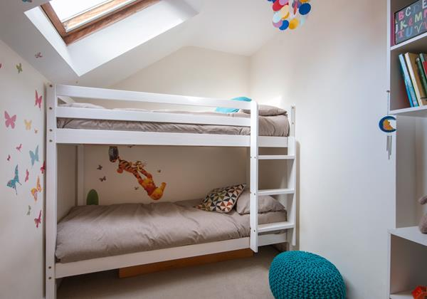 Bunk room with skylight