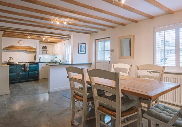 Open plan kitchen family dining with beamed ceiling