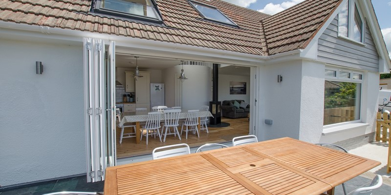 Bifold doors with decking area and BBQ