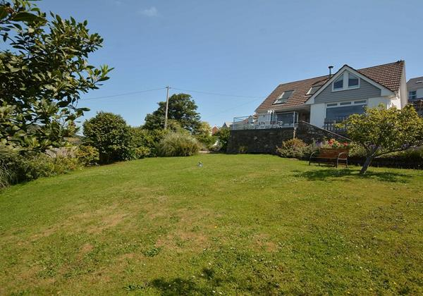 Large lawned garden with countryside views